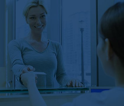 Smiling woman at front desk