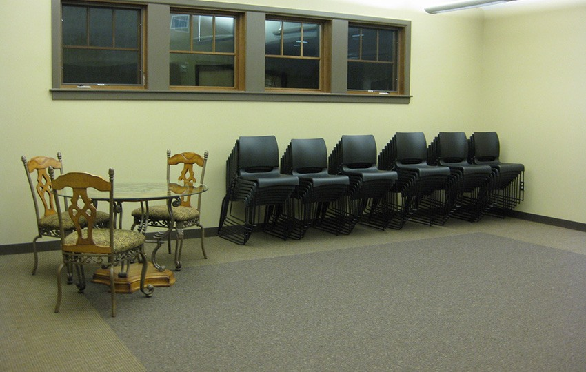 Large open room with stacks of chairs