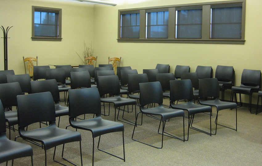 Rows of black chairs in conference room