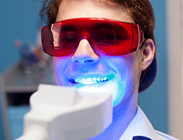 Man receiving in-office teeth whitening treatment