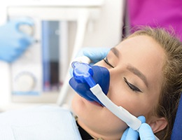 Relaxed patient with eyes closed in dental chair