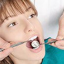 Woman receiving teeth cleaning