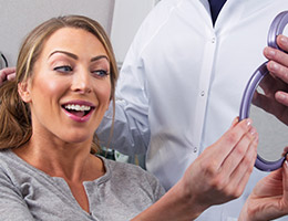 Woman looking at smile in mirror