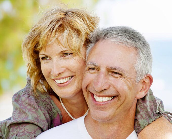Smiling older couple outdoors