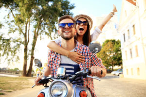 portrait of a young couple on motorcycle